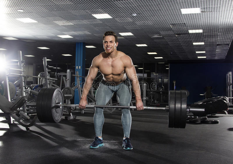 Attractive muscular shirtless athlete doing heavy deadlift exer royalty free stock photos