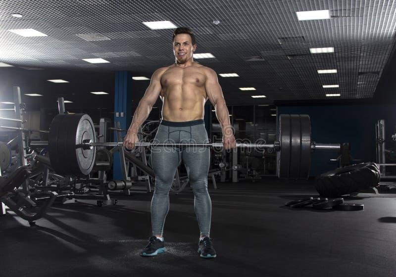 Attractive muscular shirtless athlete doing heavy deadlift exer stock photos