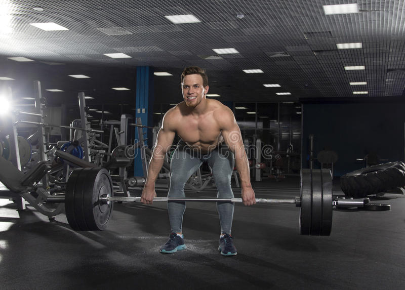 Attractive muscular shirtless athlete doing heavy deadlift exer royalty free stock image