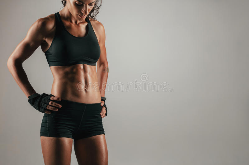 Attractive muscular woman with strong abs royalty free stock photos