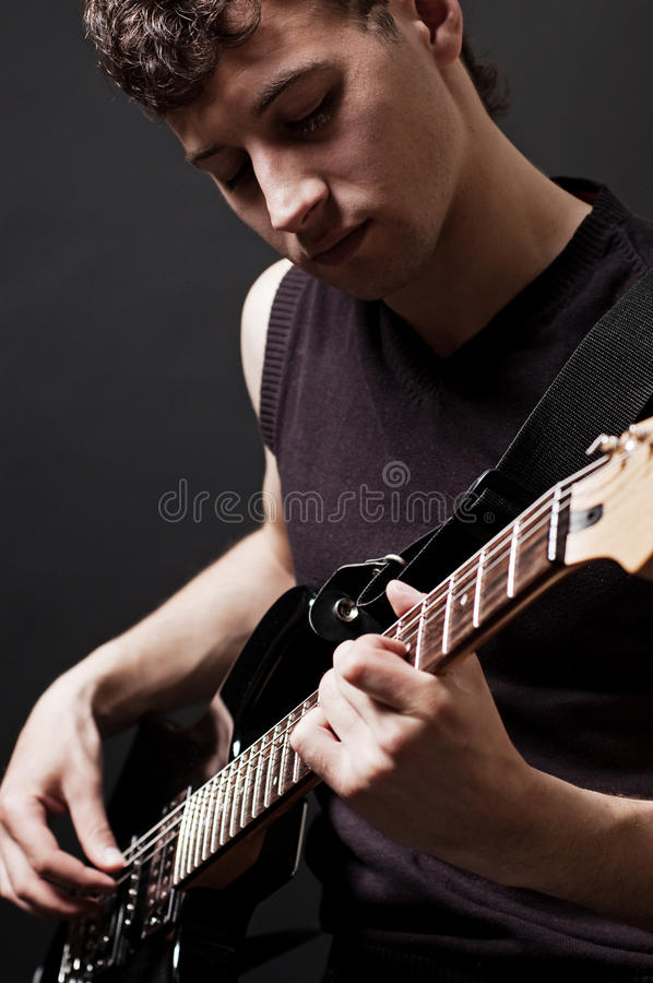 Attractive musician with guitar royalty free stock images