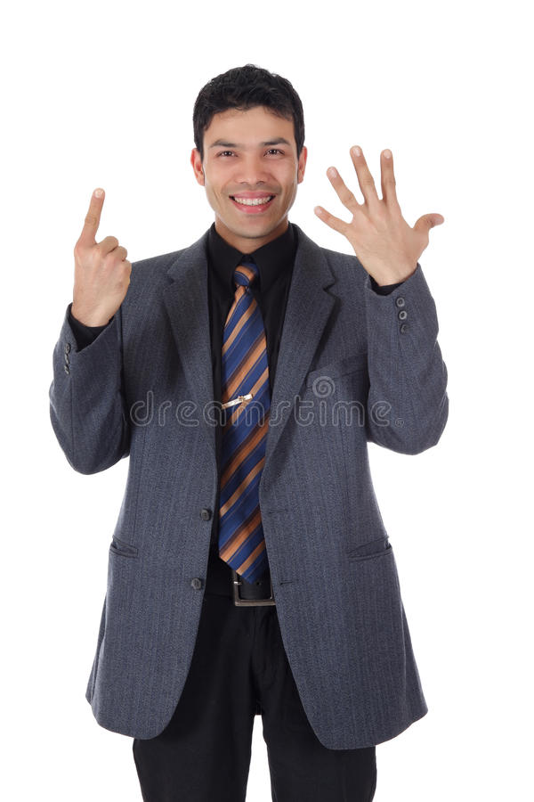 Attractive Nepalese businessman, fingers. Attractive young Nepalese businessman shows six fingers. Pointing. Counting on one's fingers. Studio shot. White royalty free stock photography