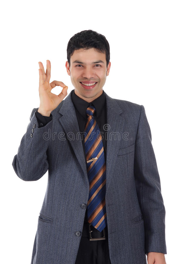 Attractive Nepalese businessman, okay. Attractive young Nepalese businessman gesturing okay. Studio shot. White background stock photos
