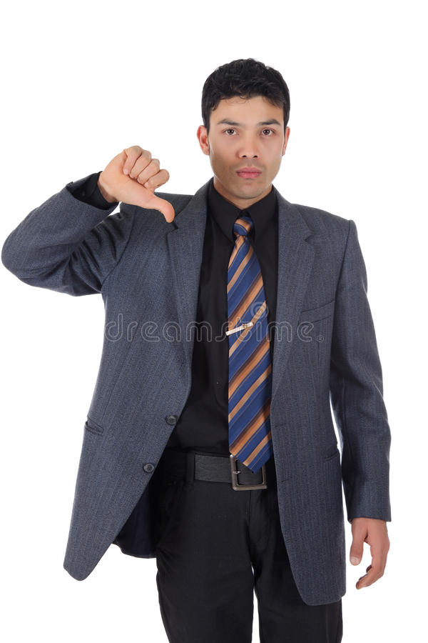 Attractive Nepalese businessman, thumb down. Attractive young Nepalese businessman gesturing thumb down. Studio shot. White background stock photo