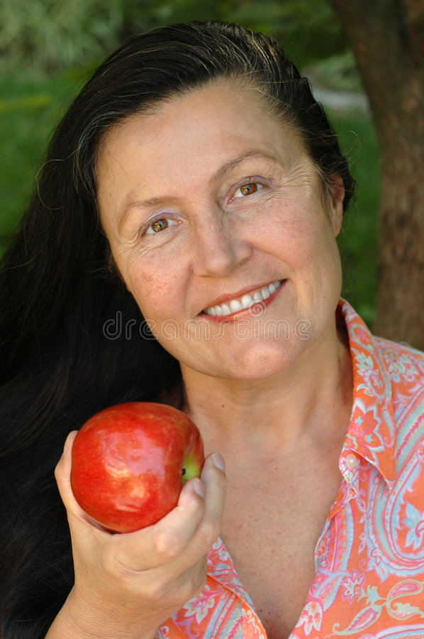 Attractive Older Woman Holding Royalty Free Stock Image