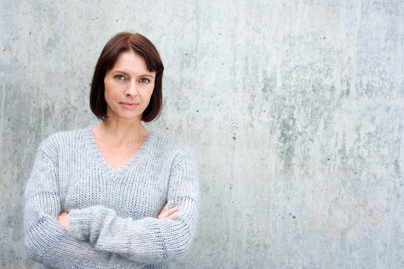 Attractive older woman in wool sweater royalty free stock photo