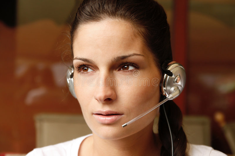 Attractive operator with headset royalty free stock photo