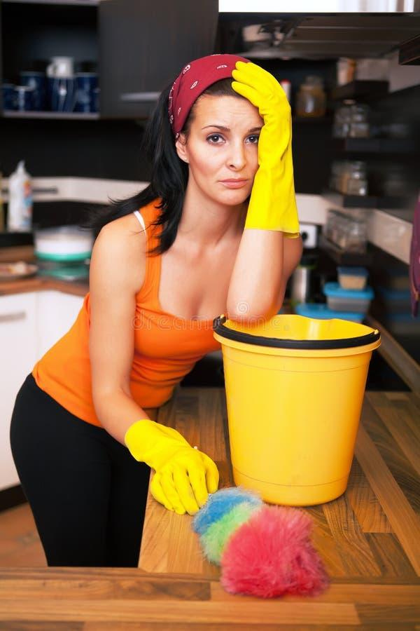 Attractive overworked  woman in kitchen