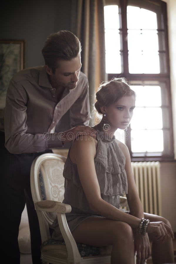 Attractive pair. In a stylish interior royalty free stock image