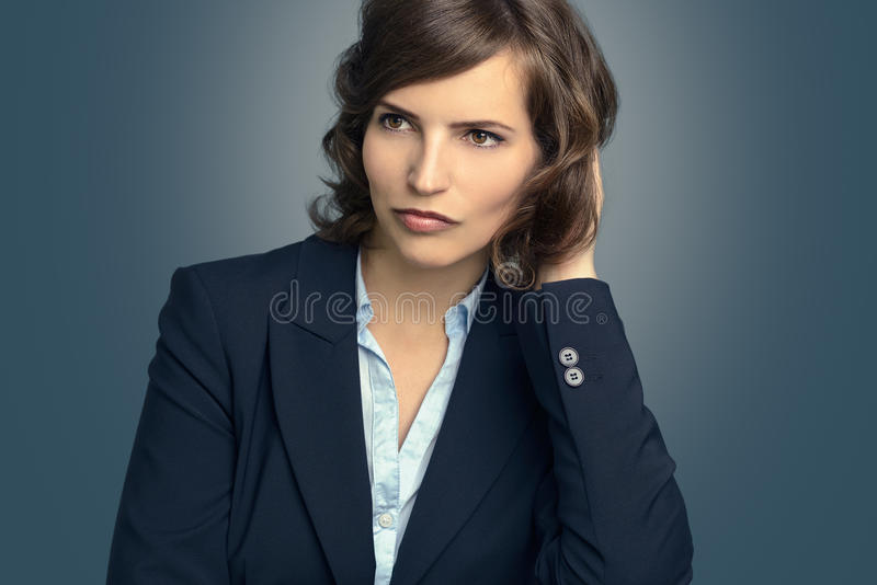 Attractive pensive woman staring into space royalty free stock images