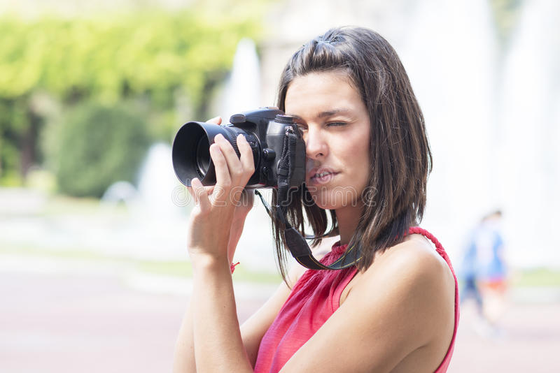 Attractive photographer using camera. stock images