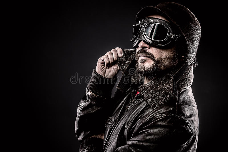 Attractive pilot era hat and glasses. Era royalty free stock photography