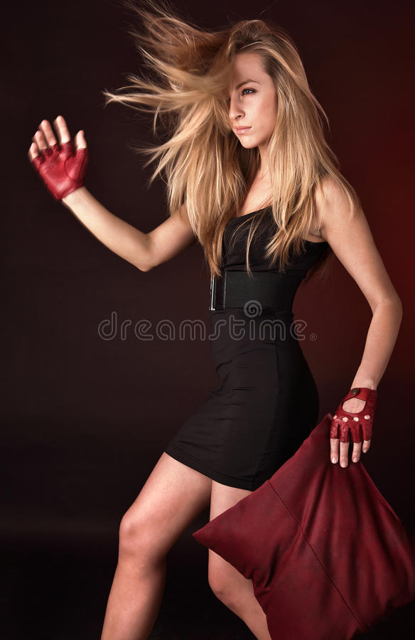 Attractive Posing Blonde In A Red Sport Gloves Royalty Free Stock Photos