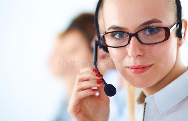Attractive positive young businesspeople and. Colleagues in a call center office royalty free stock photos