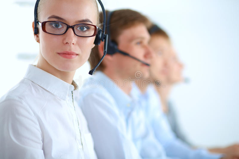 Attractive positive young businesspeople and colleagues in a call center office.  stock image
