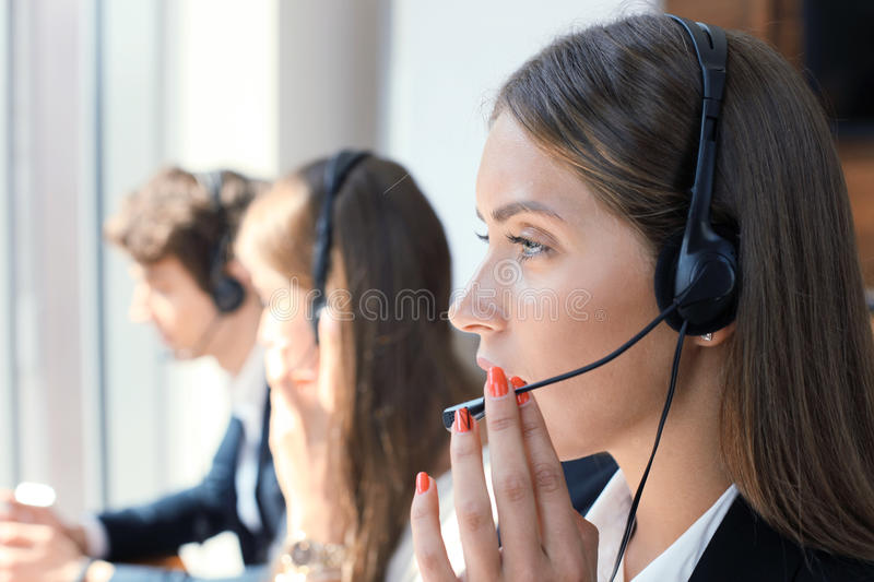 Attractive positive young businesspeople and colleagues in a call center office. royalty free stock photos
