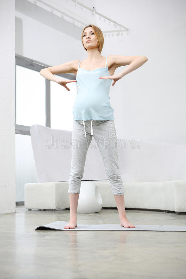Download Attractive Pregnant Woman Exercising Stock Photo - Image: 33366272
