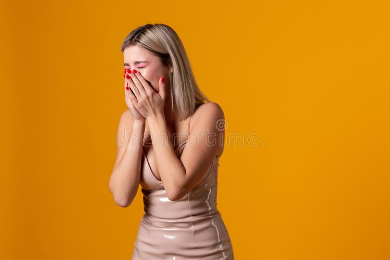 Attractive pretty and charming woman closed her mouth with crossed hands stock photography