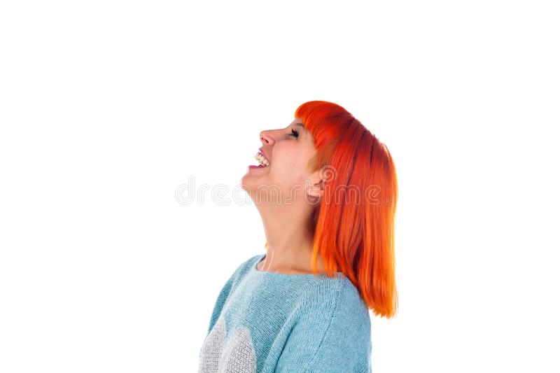 Attractive profile of a redhead girl looking up royalty free stock photography