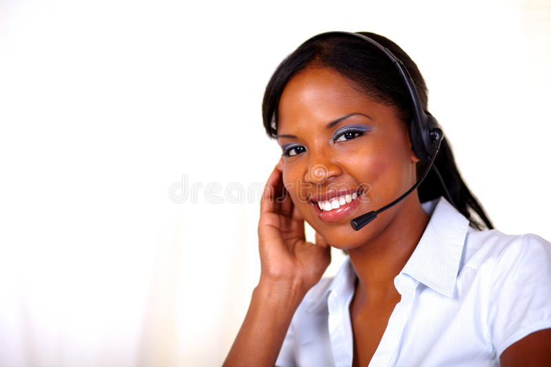 Download Attractive Receptionist Smiling And Looking At You Stock Photo - Image: 26555646