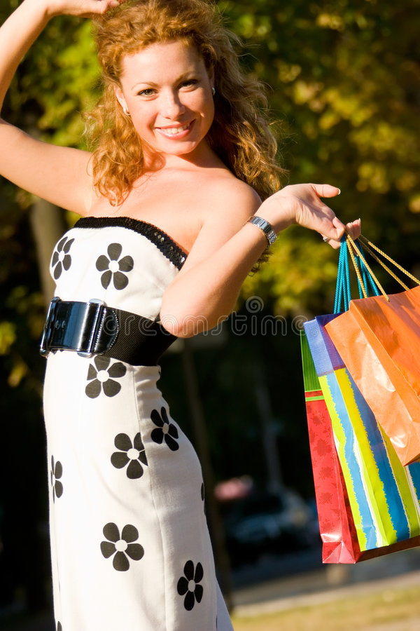 Free Attractive Red-haired Woman With Shopping Bags Royalty Free Stock Images - 6577589