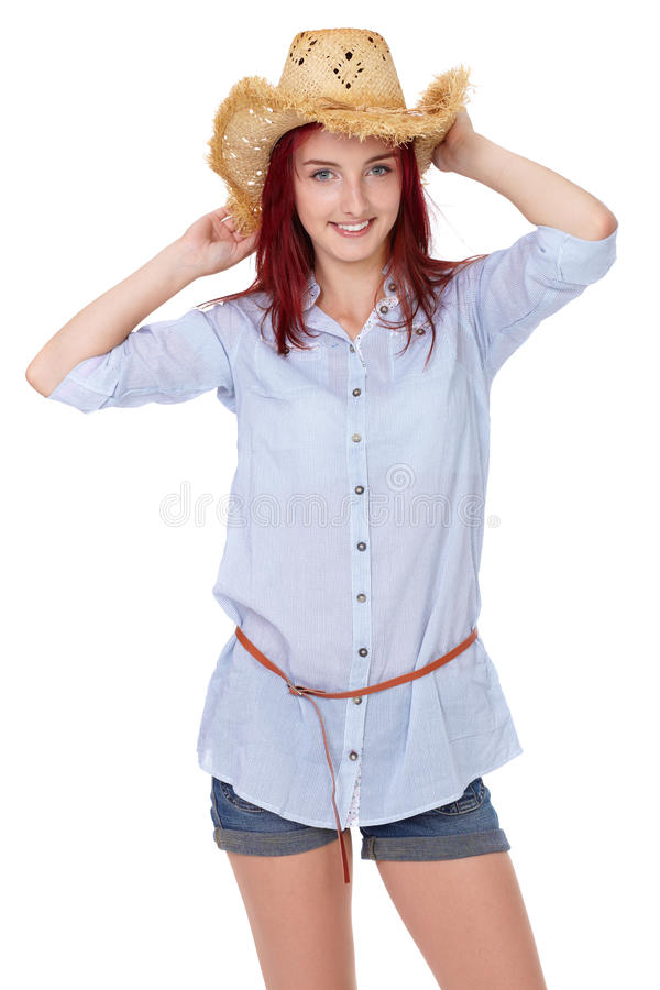 Attractive redhead girl with straw hat, isolated stock photo