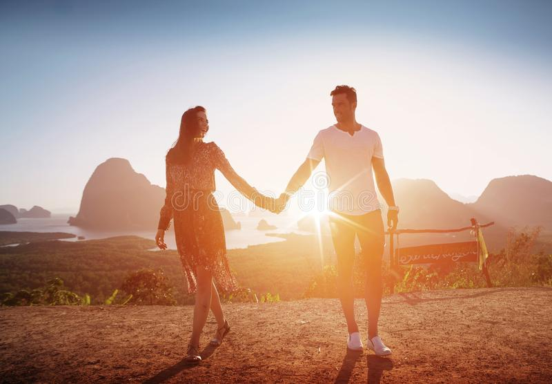 Attractive couple posing against an island landscape royalty free stock photos