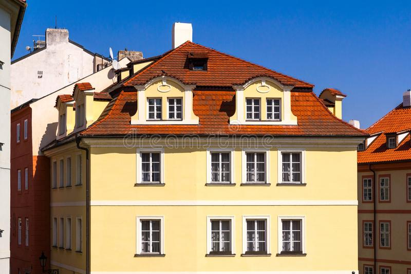 Low-rise city apartment building with double dormer windows royalty free stock image