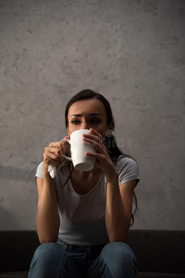 Attractive sad woman drinking coffee. At home royalty free stock images