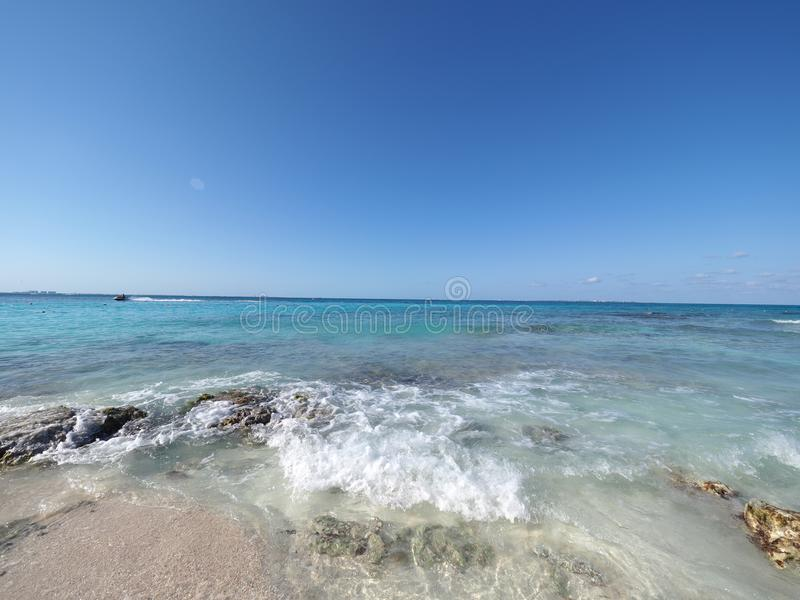 Attractive seascape panorama of turquoise waters of Caribbean Sea landscape with horizon line at Cancun city in Mexico. Attractive seascape panorama of turquoise stock image