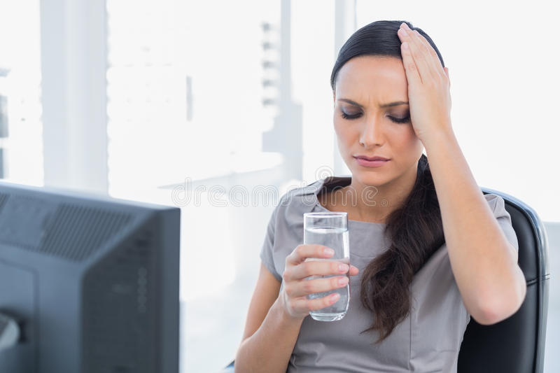 Attractive Secretary With Headache Holding Water And Touching He Stock Photos