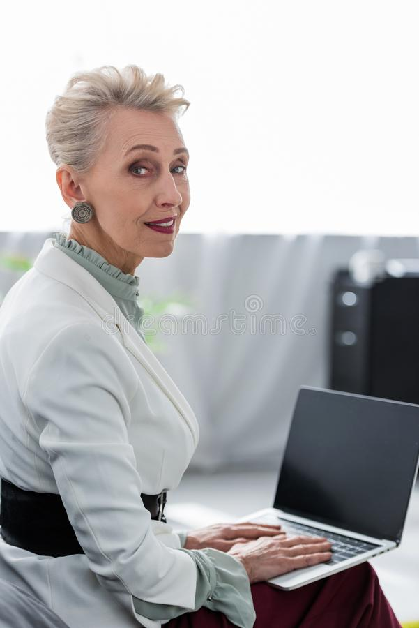attractive senior business woman using laptop royalty free stock image