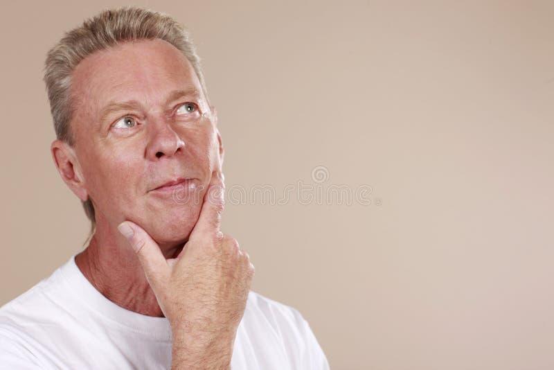 Attractive senior considering stock photos