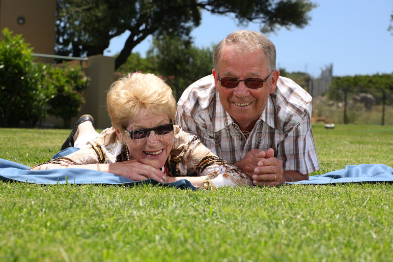 Attractive senior couple. Relaxing outdoors stock images
