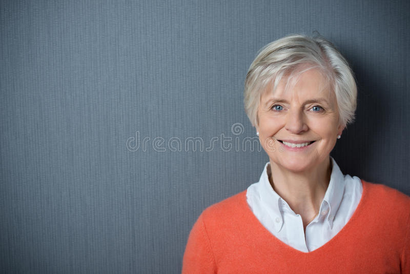 Attractive senior woman with a beaming smile stock images