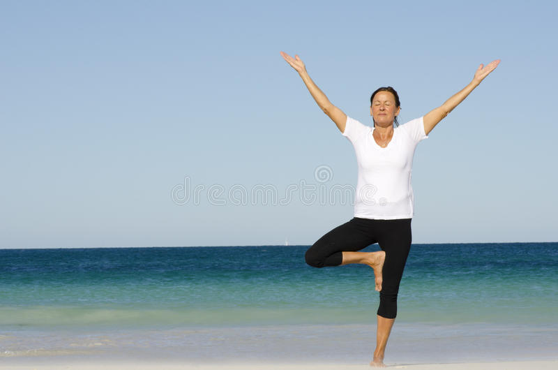 Download Attractive Senior Woman Stretching At Beach Stock Photo - Image: 23648608