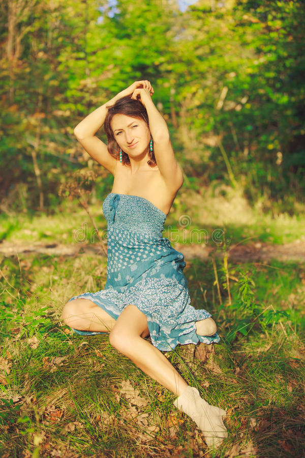 Attractive sensual young girl posing in the forest royalty free stock photography