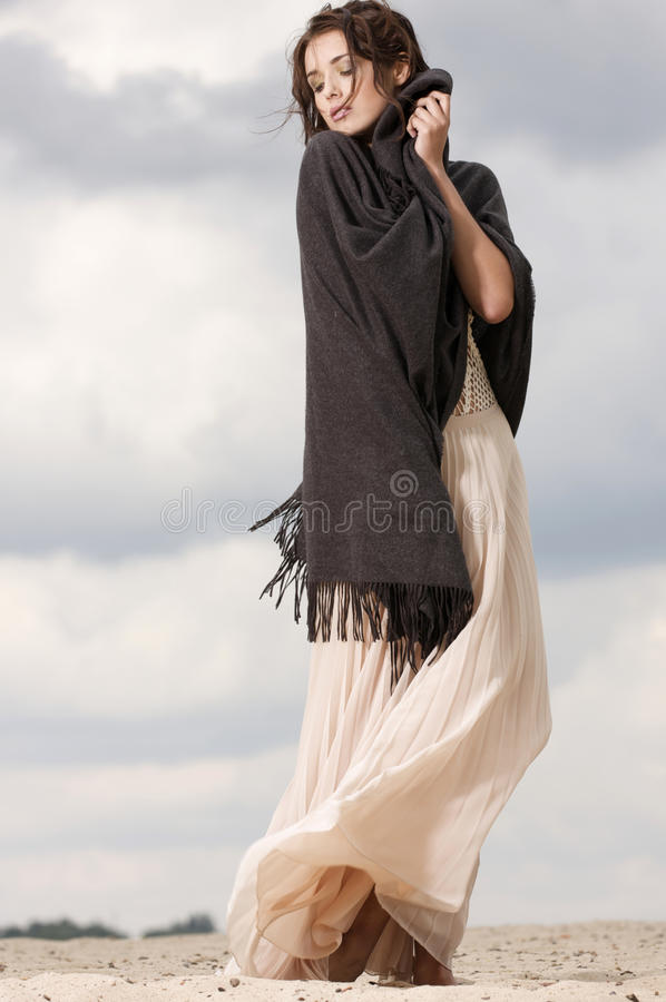 Attractive and sensuality woman in the desert royalty free stock photography