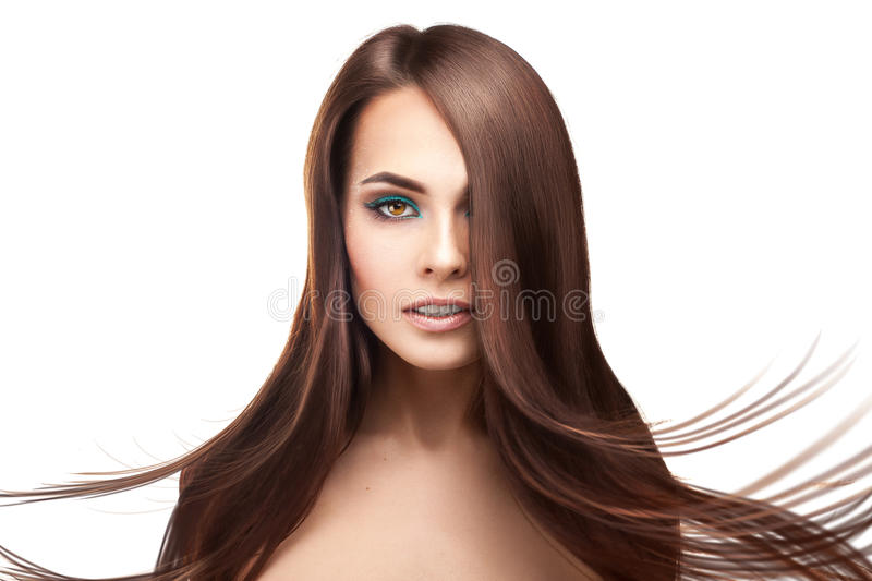 Attractive serious brunette lady with makeup and perfect straigh stock image