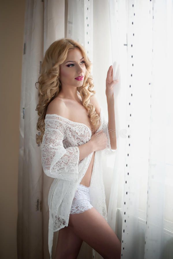 Download Attractive Blonde With White Lace Lingerie Near The Curtains Looking On The Window. Portrait Of Sensual Long Fair Hair Woman Stock Images - Image: 36300214