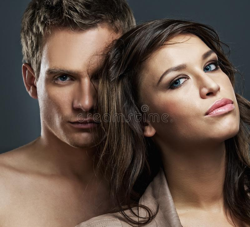 Attractive couple. Isolated on grey background royalty free stock images