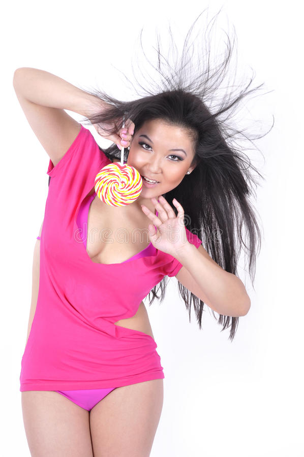 Download Attractive Girl With Lollipop Stock Photo - Image of isolated, hair: 13306786