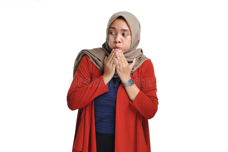 Attractive shocked expression of young Asian woman standing with hijab stock photo