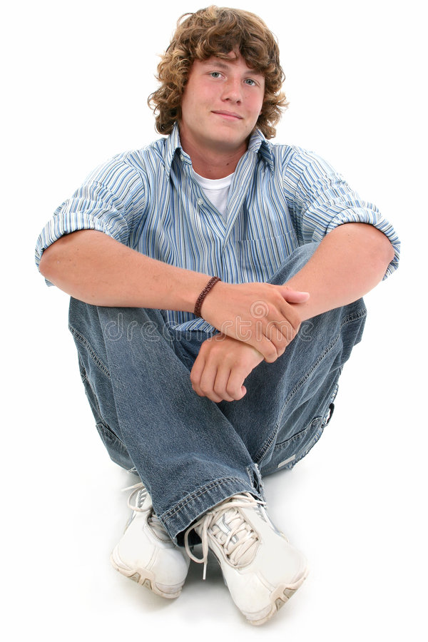 Download Attractive Sixteen Year Old Teen Boy Sitting On Floor Stock Photo - Image: 193102