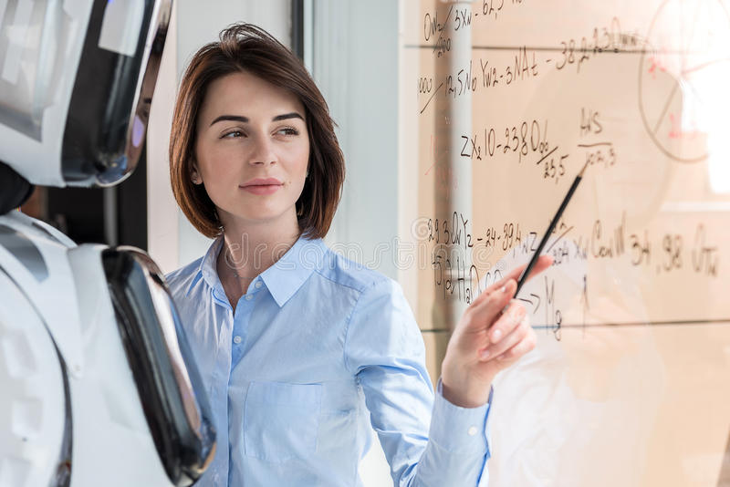 Attractive smart girl is working with android royalty free stock image