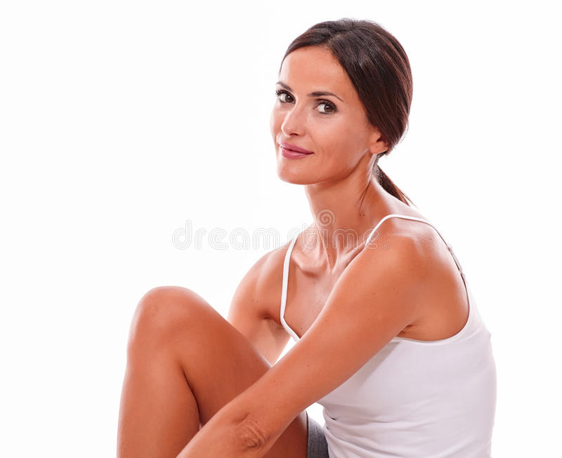 Attractive smiling brunette young woman only stock photography