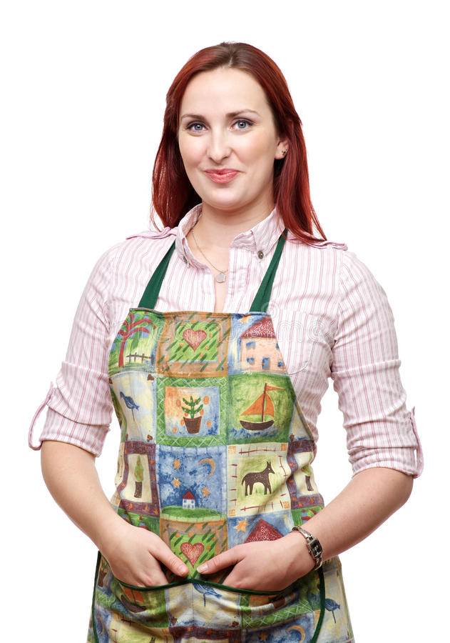 Attractive smiling lady in apron stock image