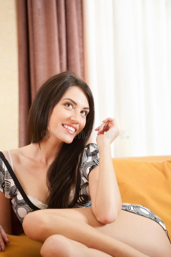 Download Attractive Smiling Girl Sitting On Sofa Stock Image - Image of adult, looking: 8173371