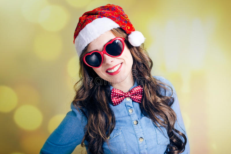 Attractive smiling teenage girl in Santa hat and royalty free stock photography