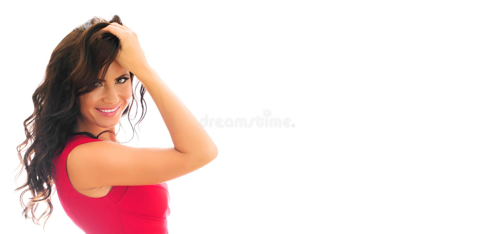 Attractive smiling woman in red dress. Isolated on white. Place for your text stock photography